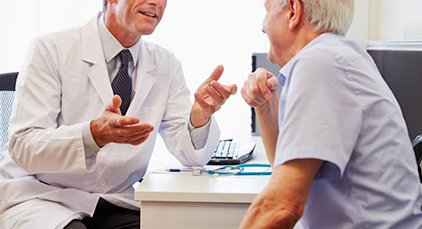 Male doctor talking with a patient